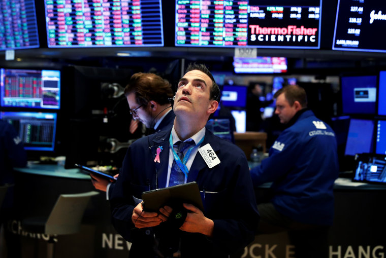 Image: Traders work the floor of the New York Stock Exchange on March 20, 2020.