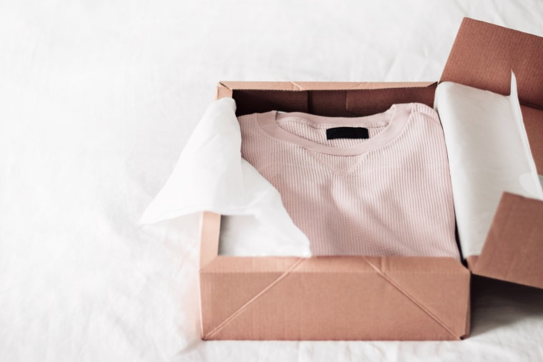 Image: High Angle View Of Shirt and Box On Bed