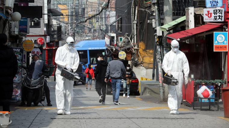 Image: Quarantine workers spray disinfectants at night spots of Itaewon neighborhood, following the coronavirus disease (COVID-19) outbreak, in Seoul
