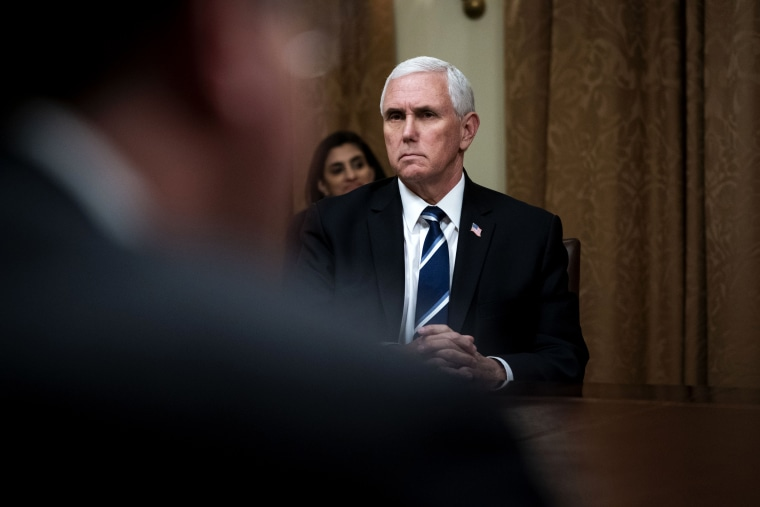 Image: Vice President Mike Pence listens during a meeting in the Cabinet Room of the White House on April 27, 2020.