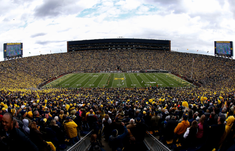 Image: The Michigan Wolverines kick off against the Michigan State Spartans at Michigan Stadium in Ann Arbor in 2015.