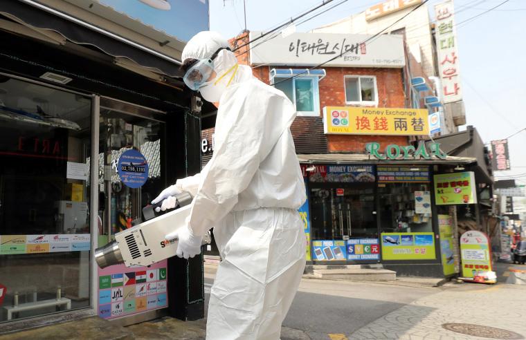 Image: A quarantine worker sprays disinfectants at night spots of Itaewon neighborhood, following the coronavirus disease (COVID-19) outbreak, in Seoul