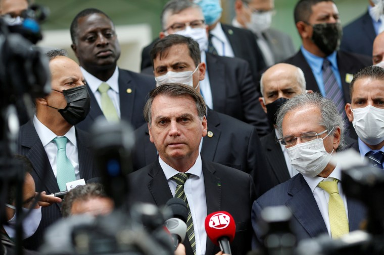 Image: FILE PHOTO: Brazil's President Jair Bolsonaro speaks with journalists after a meeting with President of Brazil's Supreme Federal Court Dias Toffoli, amid the coronavirus disease (COVID-19) outbreak, at the Supreme Federal Court in Brasilia