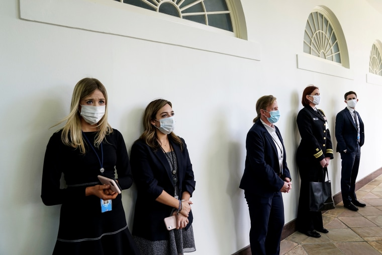 Image:  Members of the White House staff and Secret Service along the West Wing colonnade on May 11, 2020.