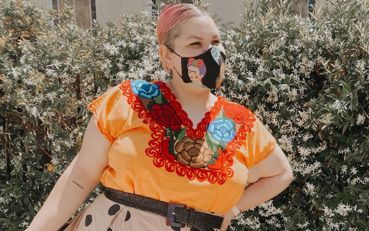 Designer Ashley Nell Tipton wears a Frida Kahlo themed mask.