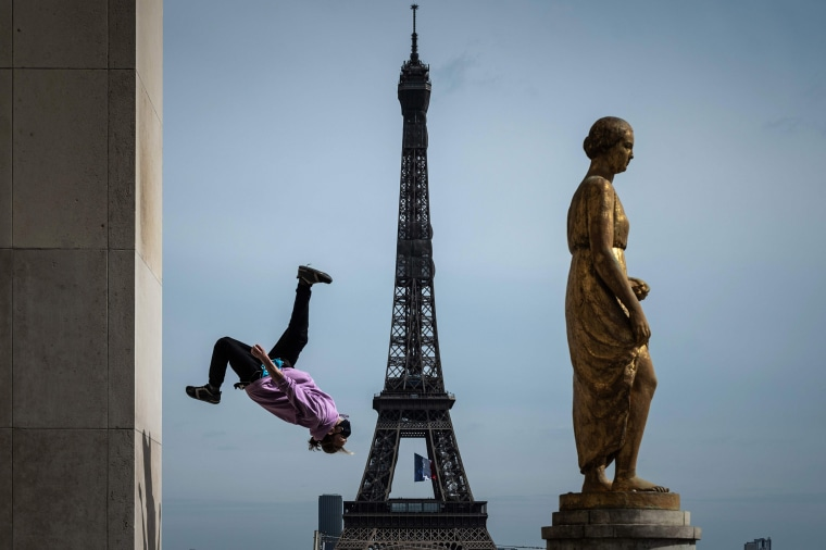 Image: French free runner Johan Tonnoir practices on Trocadero Plaza with the Eiffel Tower in background in Paris on May 11, 2020 on the first day of France's easing of lockdown measures in place for 55 days to curb the spread of the COVID-19 pandemic