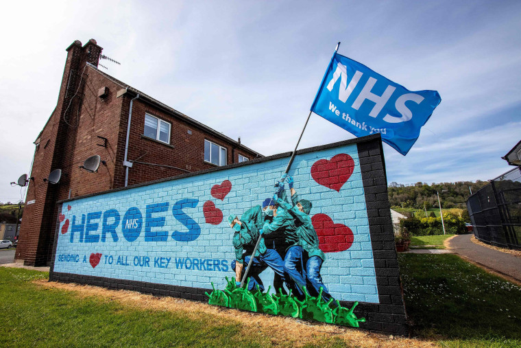 Image: BRITAIN-NIRELAND-HEALTH-VIRUS-MURALS-NHS