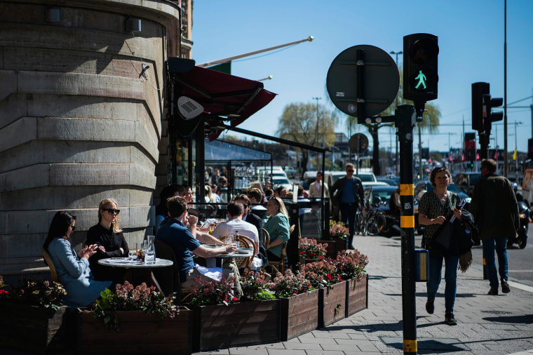 Image: People have lunch at a restaurant in Stockholm, during the coronavirus COVID-19 pandemic on April 22, 2020.