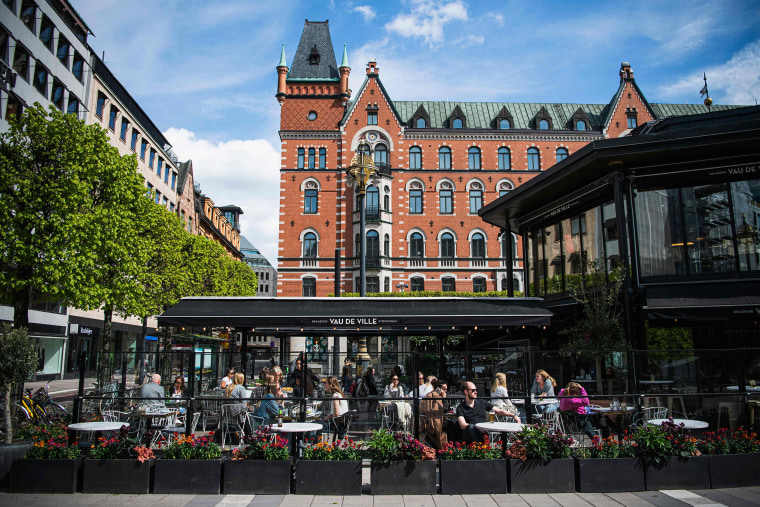 Image: People sit in a restaurant in Stockholm on May 8, 2020, amid the coronavirus COVID-19 pandemic.
