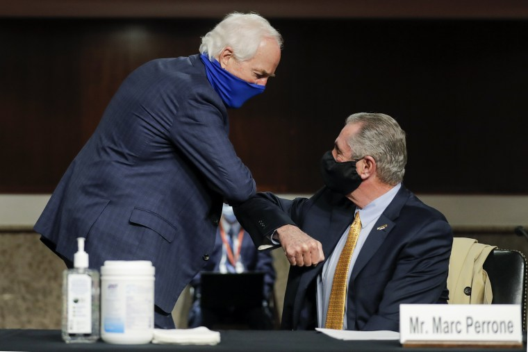 Image: Sen. John Cornyn, R-Texas, greets Marc Perrone, international president of the United Food and Commercial Workers International Union with an elbow bump, prior to the start of a Senate Judiciary Committee hearing