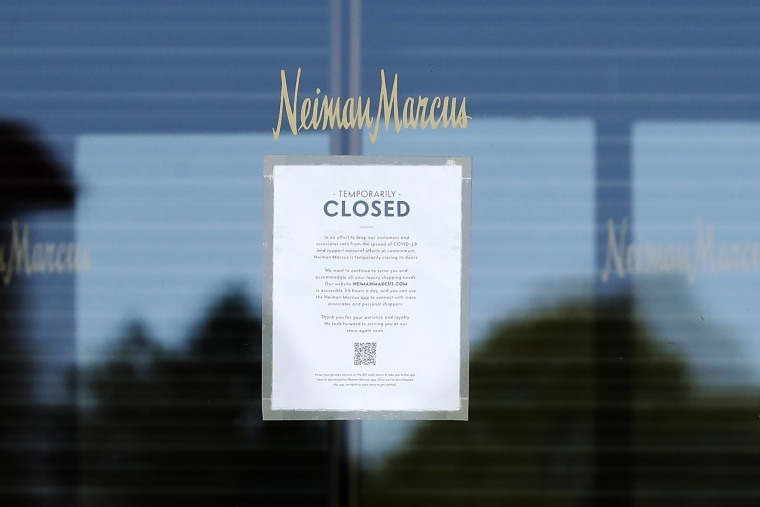 Image: A temporary closed sign shows at the Neiman Marcus department store in Northbrook, Ill