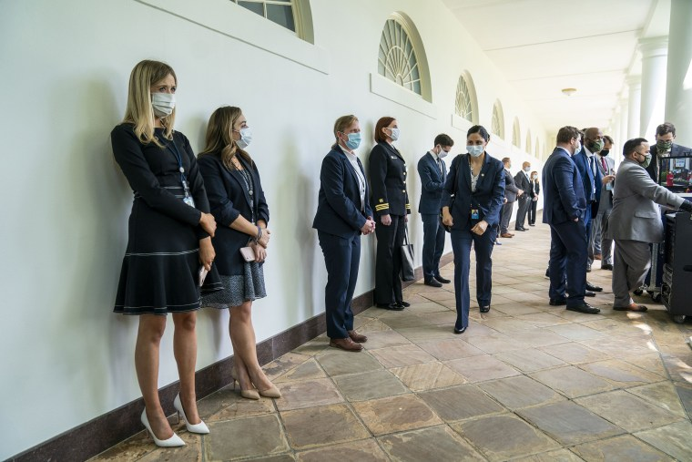 Image: White House staff and guests, wearing face masks, wait for a news conference with President Donald Trump about the coronavirus in the Rose Garden of the White House in Washington, Monday, May 11, 2020. (Doug Mills/The New York Times)