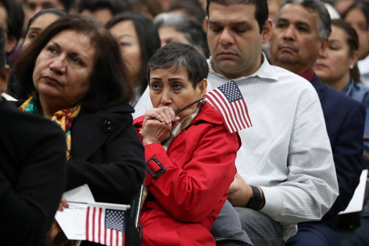Image: Immigrants participate in a naturalization ceremony to become new U.S. citizens in Los Angeles