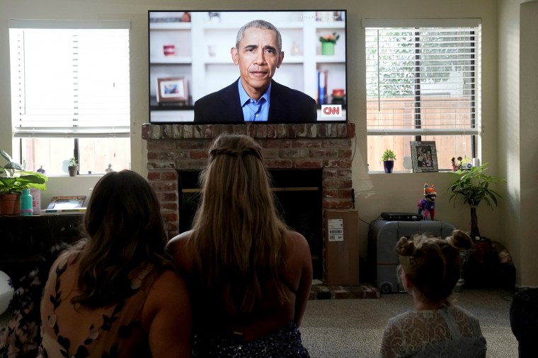 Image: Phoebe Seip, a graduating student at Torrey Pines High School, and her sisters watch Barack Obama deliver a virtual commencement address in San Diego, Calif., on May 16, 2020.