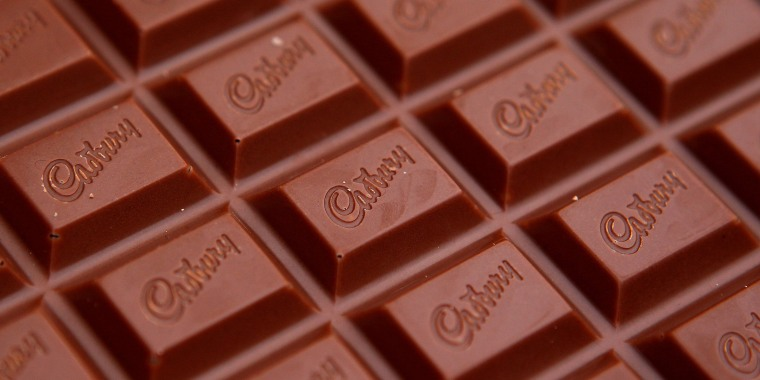 Image: FILE PHOTO: The Cadbury name is seen on a bar of Dairy Milk chocolate