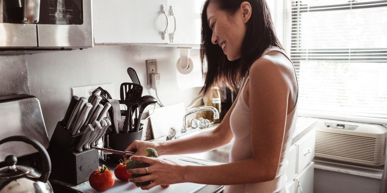 chinese woman preparing food at home