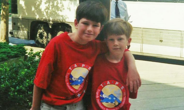 Nathaniel Lee, left, and his younger brother Sam Lee, right, are pictured as camp kids at their first TAPS Good Grief Camp in May 1999. The boys lost their father, U.S. Army Capt. Donald Lee, in a helicopter crash in December 1997.