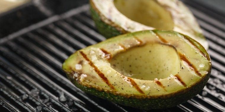 sliced fresh avocado on the grill. Health food. Barbeque avocado