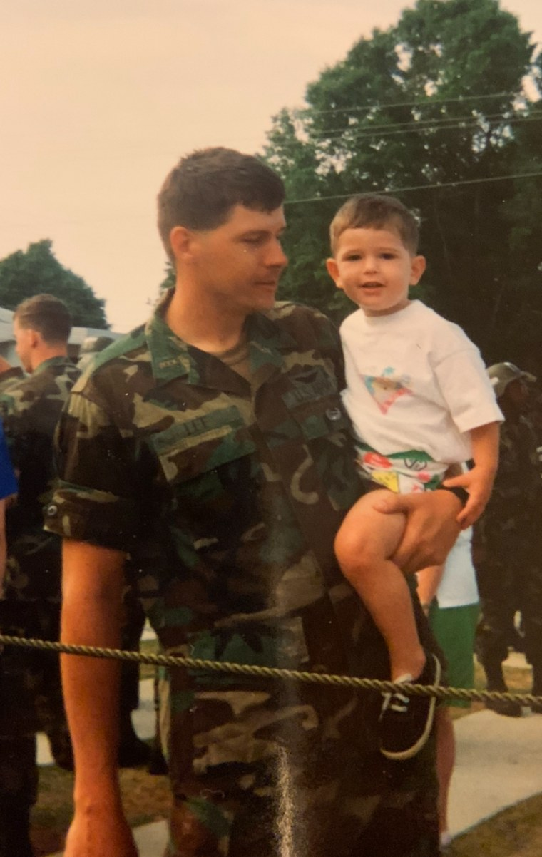 U.S. Army Capt. Donnie Lee holds his son, Nathaniel Lee, in the 1990s.