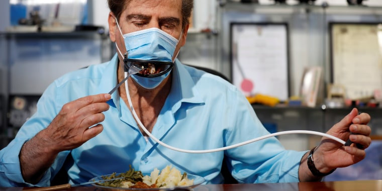 Image: Israeli inventors develop a mask that allows diners to eat food without taking it off in Or Yehuda