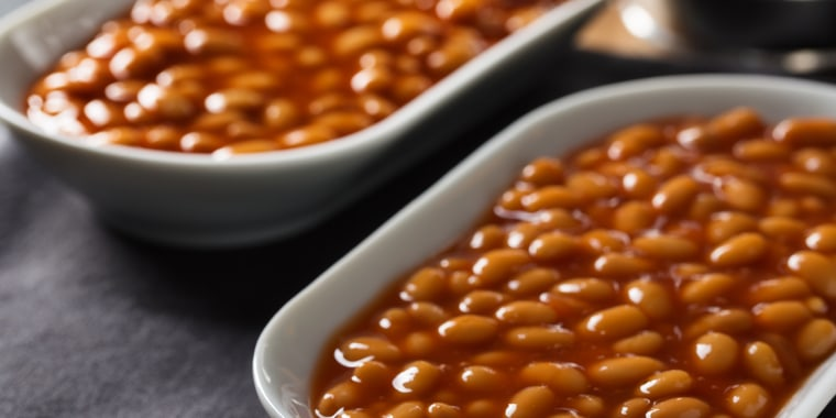 Baked beans with tomato sauce served in small bowls.; Shutterstock ID 590750336; Purchase Order: -; Segment/Job: -; Client/Licensee: -