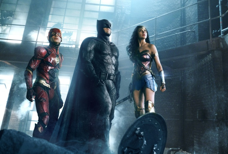 """Image: Ezra Miller as The Flash, Ben Affleck as Batman and Gal Gadot as Wonder Woman in Warner Bros. Pictures' movie \""""Justice League.\"""""""