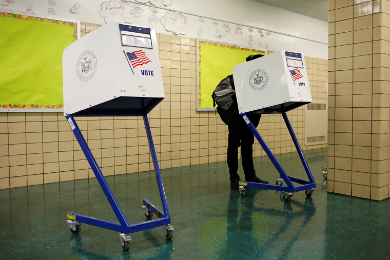 Image: Person votes during the midterm election at P.S. 140 in Manhattan, New York City