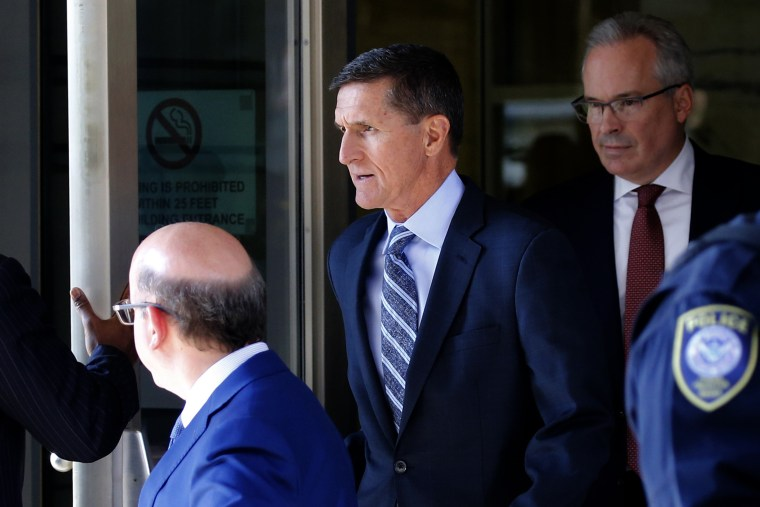 Image: Former National Security Adviser Flynn departs after plea hearing at U.S. District Court in Washington