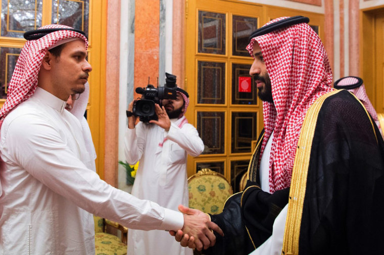 Image: Saudi crown prince shakes hands with Salah Khashoggi