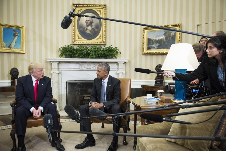 President Barack Obama talks with President-elect Donald Trump in the Oval Office
