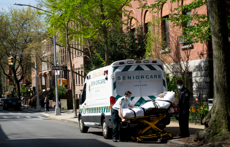 Image: Two medical workers transport and elderly patient from a nursing home in Brooklyn, N.Y., on April 24, 2020.