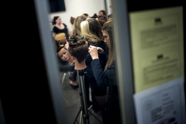 Image: Students practice cutting hair at a Paul Mitchell School in Virginia in 2013.