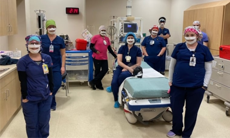 Image: The emergency department night shift at the Nanticoke Memorial Hospital in Seaford, Del., wear partially transparent masks.