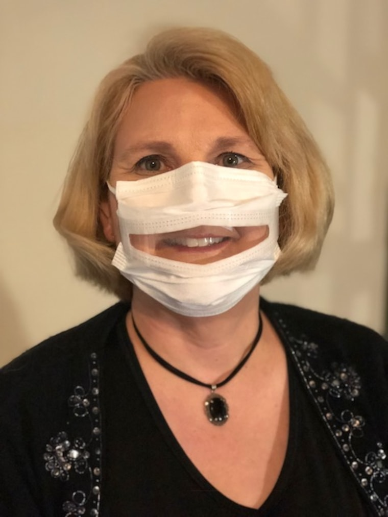 Image: Dr. Anne McIntosh, President of Safe'N'Clear, Inc., wearing a communicator mask.