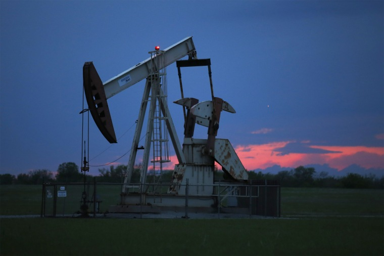 A pumpjack is pictured as the sun sets in Oklahoma City on April 21, 2020.  Google says it won't build custom artificial intelligence tools for speeding up oil and gas extraction, taking an environmental stance that distinguishes it from cloud computing rivals Microsoft and Amazon.