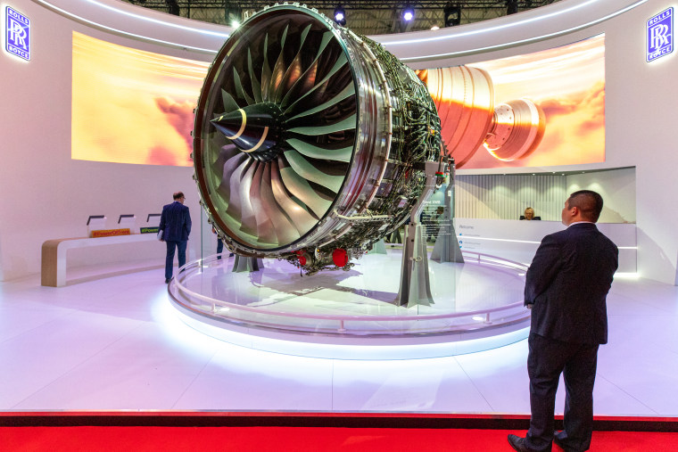 An attendee looks at a Rolls-Royce Holdings Plc Trent XWB aircraft engine on display at the Rolls Royce pavilion at the Dubai Air Show in 2019.