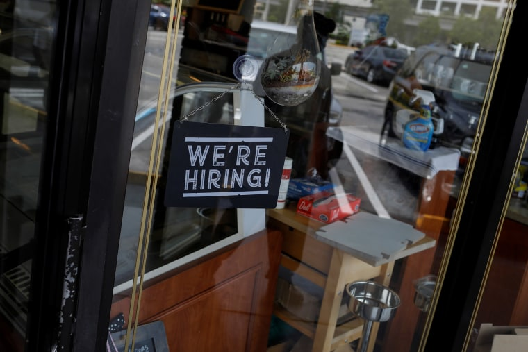 """Image: A \""""We're Hiring\"""" sign advertising jobs is seen at the entrance of a restaurant, as Miami-Dade County eases some of the lockdown measures put in place during the coronavirus disease (COVID-19) outbreak, in Miami"""