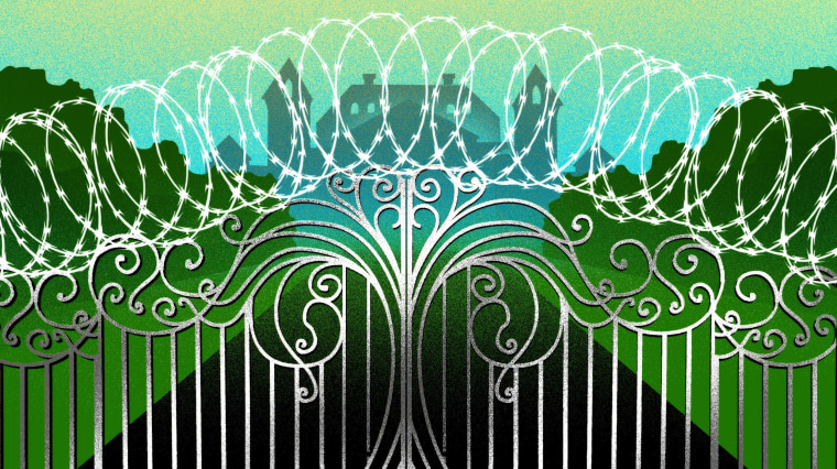 Image: An ornate gate topped with barbed wire leading to a silhouetted mansion.