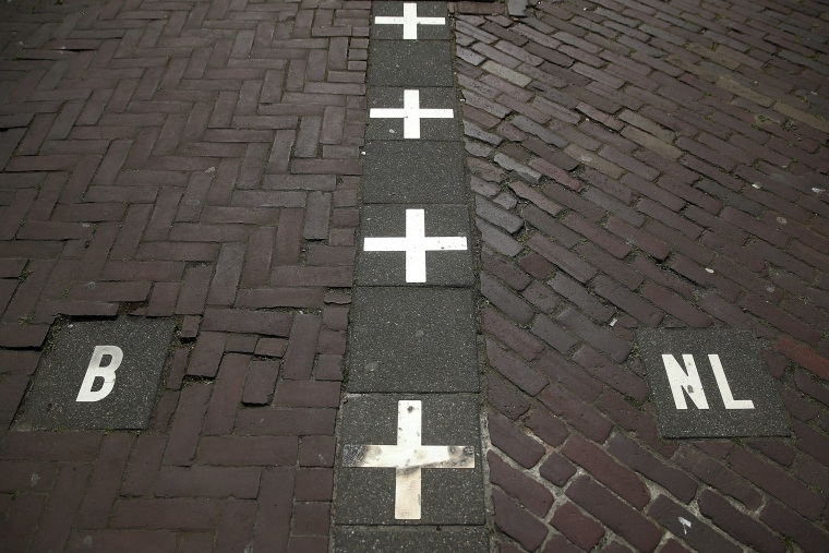 Image: A street in Baarle Nassau which is unique as it has many cross border points with Baarle-Hertog in Belgium allowing some businesses and private properties to be in both Holland and Belgium at the same time