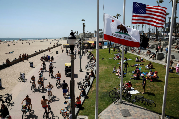Image: People visit California's Huntington Beach on Memorial Day weekend on May 23, 2020.