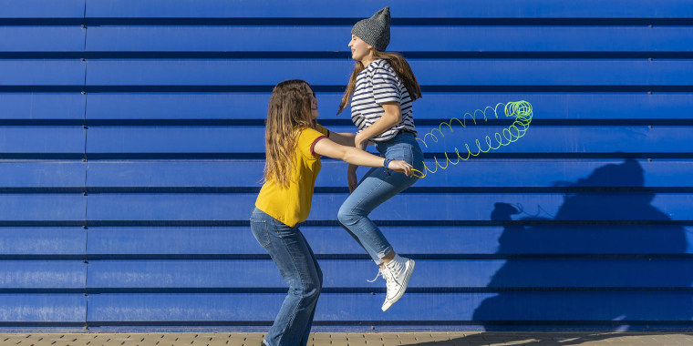 Two teenage girls having fun outdoors