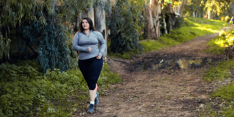 Plus size women jogging and exercising at the park