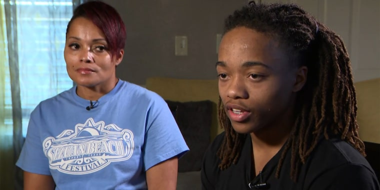 DeAndre Arnold speaks about his dreadlocks as his mother, Sandy, listens.