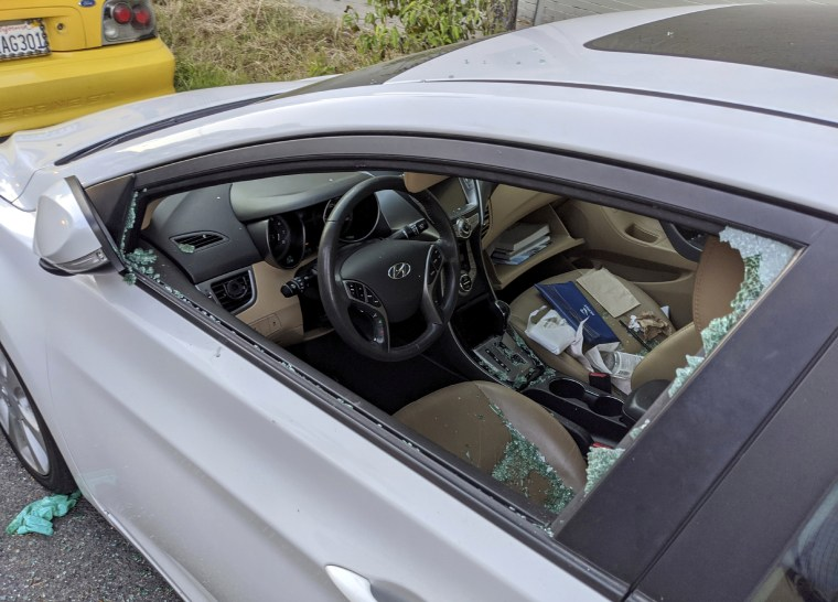 Image: A smashed window after a car was broken into on a street in Los Angeles on May 21, 2020.