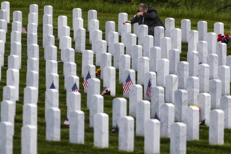 Image: Raymond Piacquadio kneels at his mother's grave at the Cemetery of the Alleghenies, a Veterans Administration National Cemetery, in Bridgeville, Pa., on May 23.