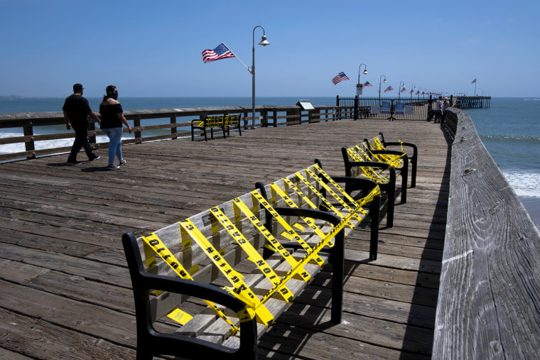 Image: Benches are blocked with caution tape near the beachfront in Ventura, Calif., on May 24.
