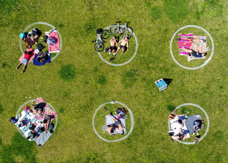 Image: People relax in social distancing circles at San Francisco's Dolores Park on May 24.