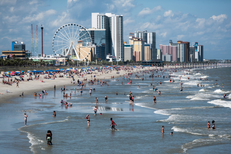 Image: People wade into the surf at Myrtle Beach, S.C., on May 23.