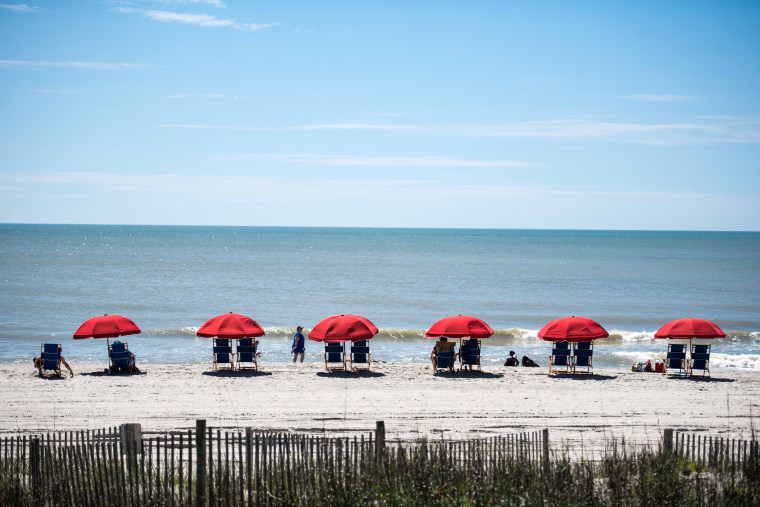 Image: Beach chairs covered by umbrellas sit on South Carolina's Myrtle Beach at the start of Memorial Day weekend on May 23.