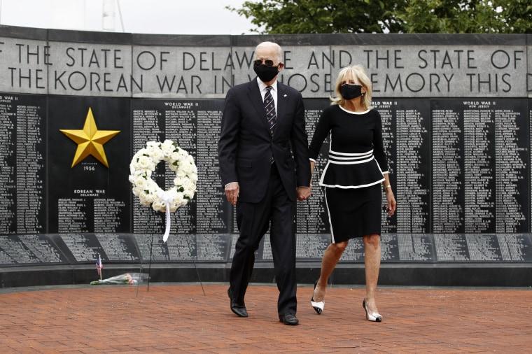 Image: Joe Biden and his wife, Jill, lay a wreath at the Veterans Memorial Park at the Delaware Memorial Bridge on May 25, 2020.